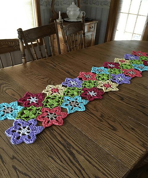 Flower Power Crochet Table Runner Pattern by Yarnspirations Design Studio