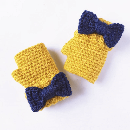 Crochet Fingerless Gloves With Bow Pattern by Peach And Paige Designs