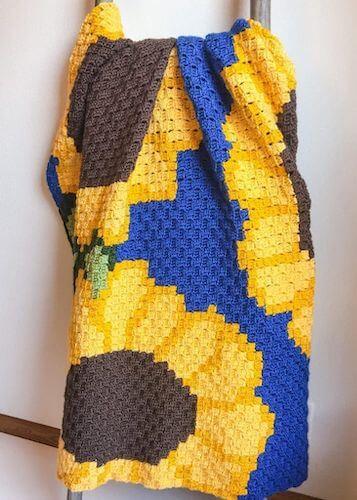 27. Sunflower C2C Crochet Blanket Pattern by Nana's Crafty Home