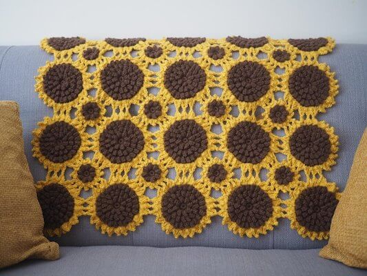 32. Sunflower Sofa Throw Crochet Pattern by Betsy Makes