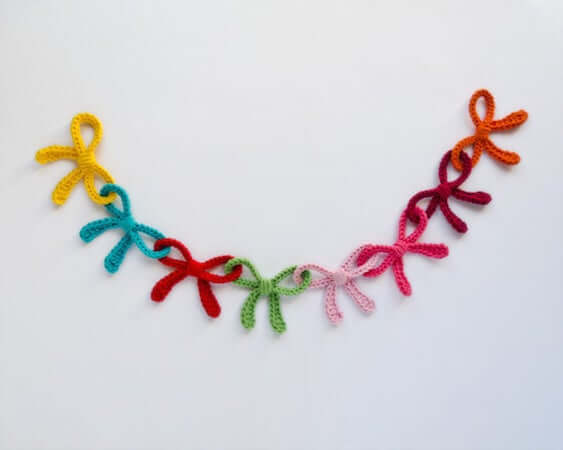 Crochet Colorful Bows Garland Pattern by One And Two Company