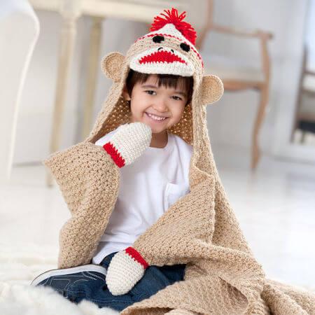 Crochet Sock Monkey Blanket Pattern by Red Heart