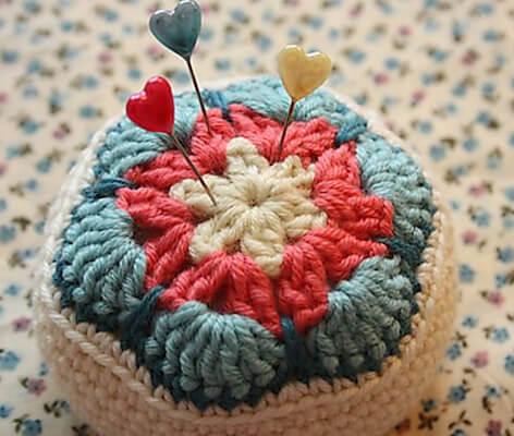 6. Crochet African Flower Pincushion Pattern by Cherry Heart